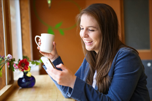 Healthy woman looking at phone
